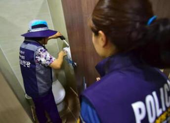 韩国偷拍成风 女性作案后被区别对待?